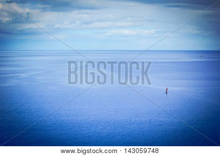 A small boat on huge beautiful ocean
