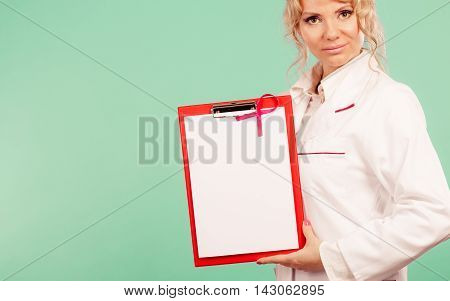 Female Doctor With Folder And Pink Ribbon
