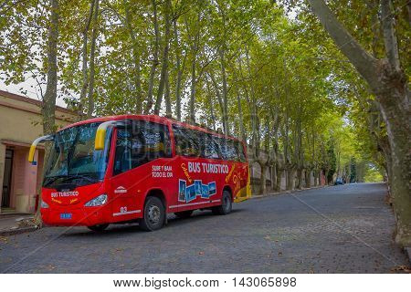 COLONIA DEL SACRAMENTO, URUGUAY - MAY 04, 2016: the city bus tour offers a ride trough the city and all the main turistic places.
