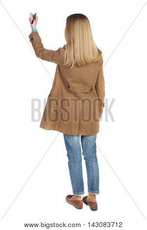 back view of writing beautiful woman. Rear view people collection.  backside view of person. Isolated over white background. The blonde in a brown cloak draws felt-tip pen on the board.