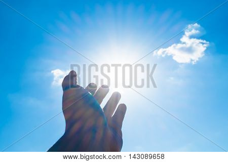 Open Hand Point To Sun At Blue Sky And Cloud
