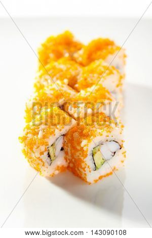 Japanese Sushi Roll - Shrimp and Avocado inside. Tobiko outside