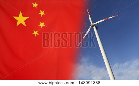 Concept clean energy with flag of China merged with wind turbine in a blue sunny sky