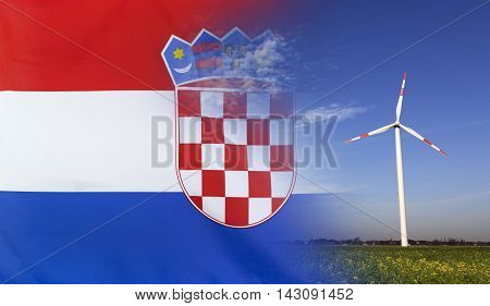 Concept clean energy with flag of Croatia merged with wind turbine in a blue sunny sky and green grass with flowers