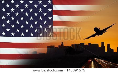 Travel and transport concept with skyline silhouette highway traffic and airplane at sunset merged with real fabric flag of USA