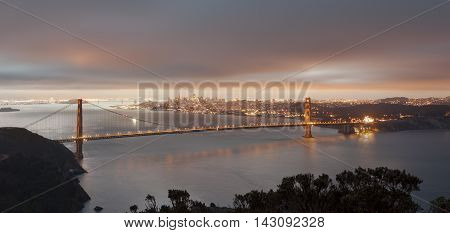 Golden Gate Bridge Sunrise Twilight transition with San Francisco downtown in the background