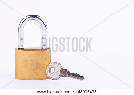 old padlock and key on white background tool isolated