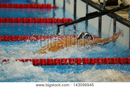 RIO DE JANEIRO, BRAZIL AUGUST 13, 2016: Olympic champion Michael Phelps of United States competes at the Men's 4x100m medley relay Final of the Rio 2016 Olympic Games at the Olympic Aquatics Stadium