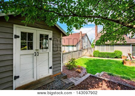 Well Kept Garden At Backyard With Barn Shed