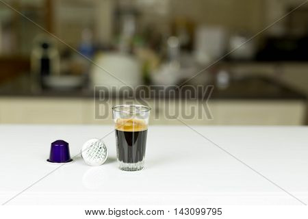Single-serve espresso shot coffee capsules in blur background