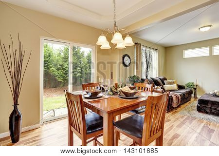 Dining Area With Wooden Table Set Connected To Living Room.