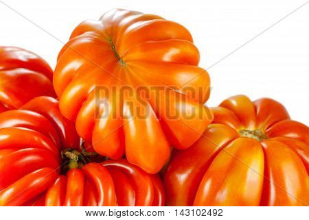 costoluto genovese tomato, closeup on white background, selective focus
