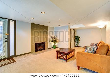 Basement Living Room Interior With Fireplace And Couch