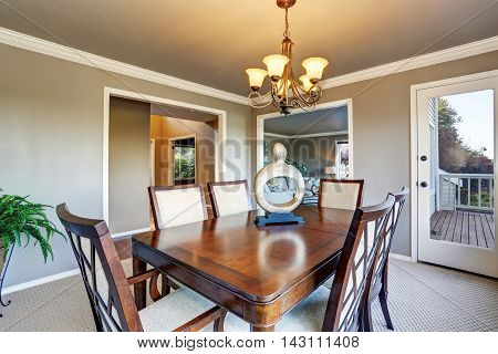 Open Floor Plan Dining Area With Exit To Walkout Wooden Deck