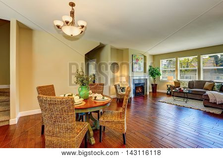 Open Floor Plan Of Dining And Living Room Interior.