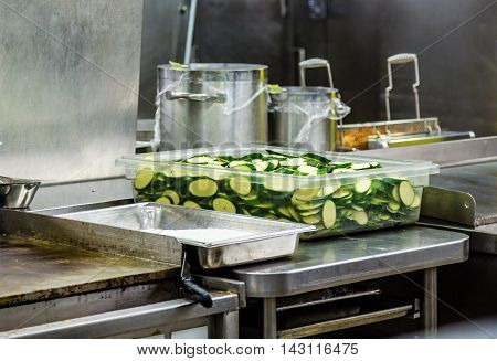 Sliced Zuchinni in a Kitchen Prep Area
