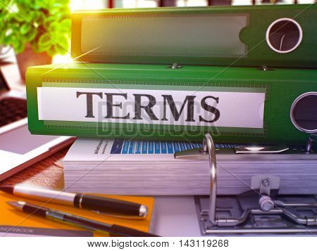 Green Office Folder with Inscription Terms on Office Desktop with Office Supplies and Modern Laptop. Terms Business Concept on Blurred Background. Terms - Toned Image. 3D.