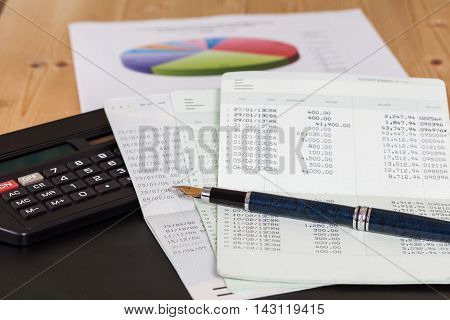 Saving account book from bank and chart on wood
