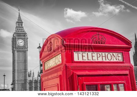 London, England - Classic British red telephone box with Big Ben on a sunny day -black and white version - UK