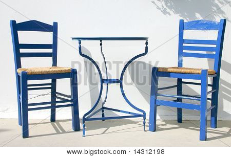 Two greece chairs and a table