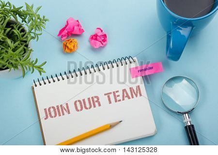 Join our team. Office desk table with notepad, pencil and coffee cup. Top view