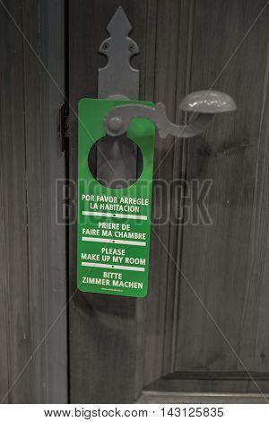 Door sign hanger on a handle - Please Make Up My Room