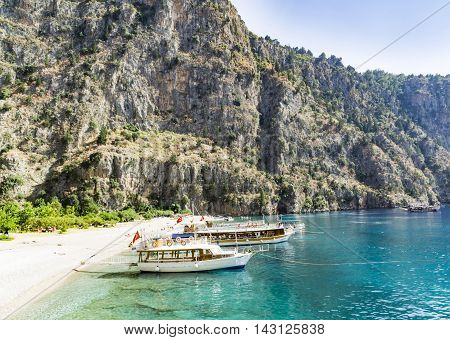 BUTTERFLY VALLEY BEACH TURKEY - JUNE 01: Tourists visit famous Butterfly Valley beach near Oludeniz in Turkey on JUNE 01 2016. Butterfly Valley beach is one of the best beaches in Turkey