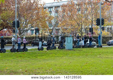 Canberra Australia - May 07 2016: Group of people on Segway city tourist tour in Canberra ACT Australia