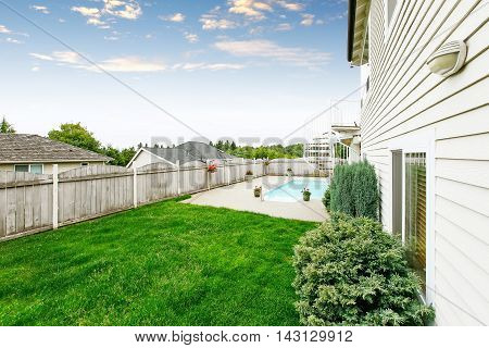 Spacious Backyard Area With Wooden Fence And Well Kept Lawn