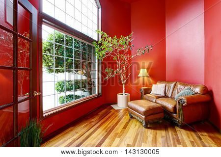 Rest Area With Red Walls, Big Window And Leather Sofa