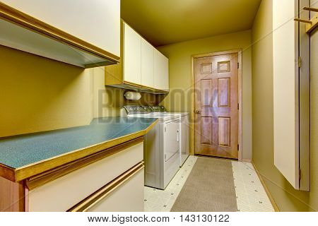 Traditional Laundry Room With Tile Floor, And Washer Dryer Combo.