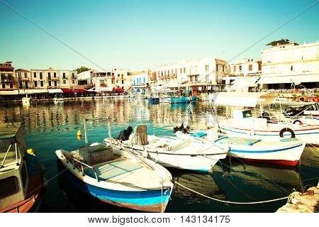 Rethymnon old city center with boats in sea bay impressions of Greece