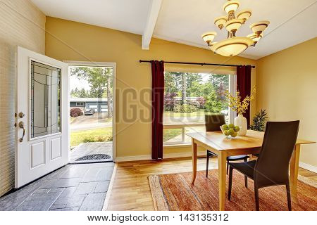 Dining Room With Table Set, Hardwood Floor And Red Curtains.
