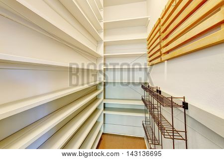 Empty Shelves In A Home Pantry With Tile Floor.