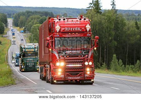 IKAALINEN, FINLAND - AUGUST 11, 2016: Red Scania R450 year 2016 Omerta of Weeda Transport from Holland takes part in truck convoy to the annual trucking event Power Truck Show 2016 in Alaharma Finland.