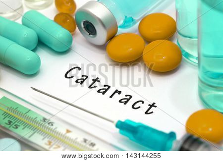 Cataract - diagnosis written on a white piece of paper. Syringe and vaccine with drugs.