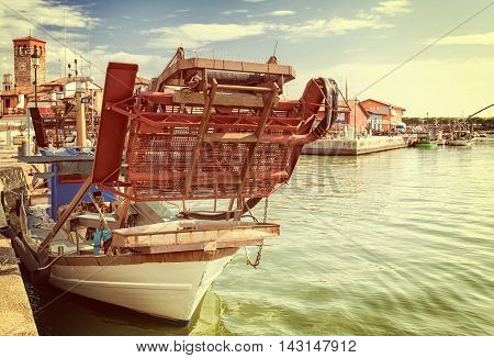 Vintage style.Draga snow blower for fishing bivalve molluscs mounted on a fishing boat