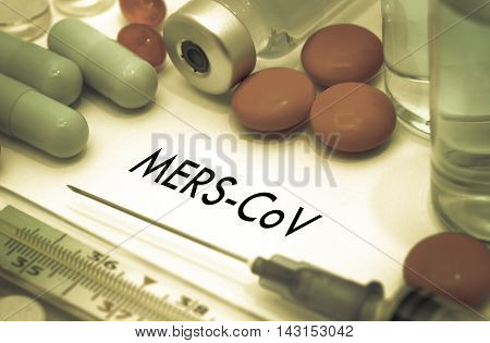 Mers-cov. Treatment and prevention of disease. Syringe and vaccine. Medical concept. Selective focus