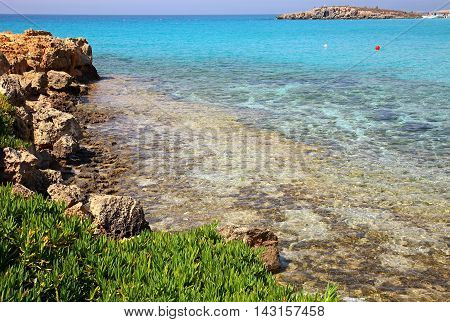 Azure sea at the Nissi beach in Ayia Napa Cyprus