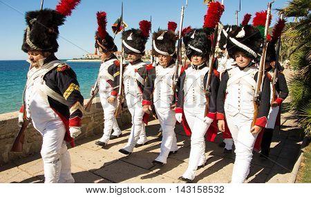 Ajaccio city Corsica island France-August 13 2016: The reenactors dressed as Napoleonic soldiers for celebration the Napoleon birthday who was born in Ajaccio.