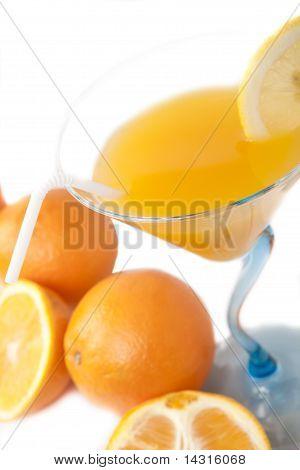 Wine glass with orange juice and fruit