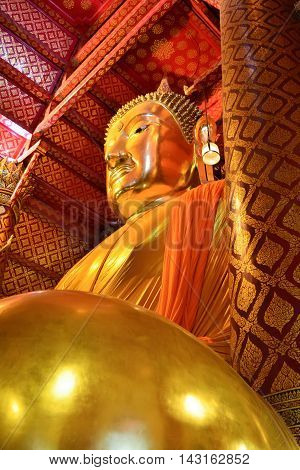 The best landmark for tourism in Ayutthaya thailand(Luang po to wat phanan cheng temple. )The Golden biggest Buddha statue in thai temple.
