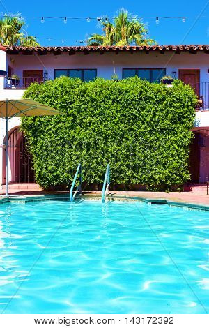 Swimming pool beside plants at a courtyard in a hacienda villa poster