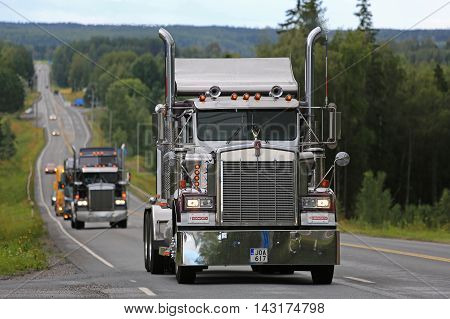 IKAALINEN, FINLAND - AUGUST 11, 2016: Classic Kenworth W900B semi moves along scenic highway as part of the truck convoy to the annual trucking event Power Truck Show 2016.