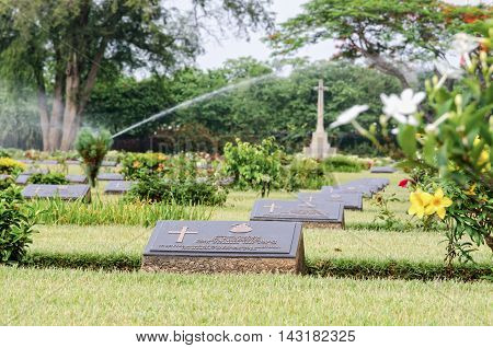 KANCHANABURI THAILAND - MAY 3 2014: Chungkai War Cemetery this is historical monuments where to respect prisoners of the World War 2 who rest in peace here MAY 3 2014 in Thailand
