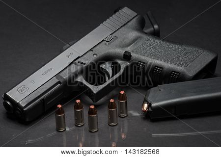 Las Vegas NV USA - January 25 2016: Closeup of Glock 17 semiautomatic handgun and 9mm amunition and magazine.