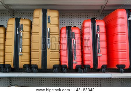 Suitcases In A Row On Shelf