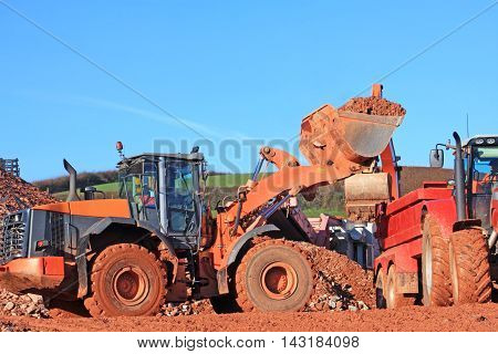 Front loader working on a road construction site