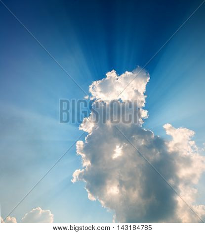 Bright beams of a sunlight because of clouds