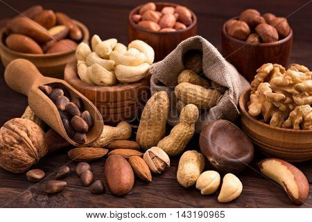 Different types of nuts. Walnut, hazelnut, cashew, peanuts, brazil nuts, pine nuts and others